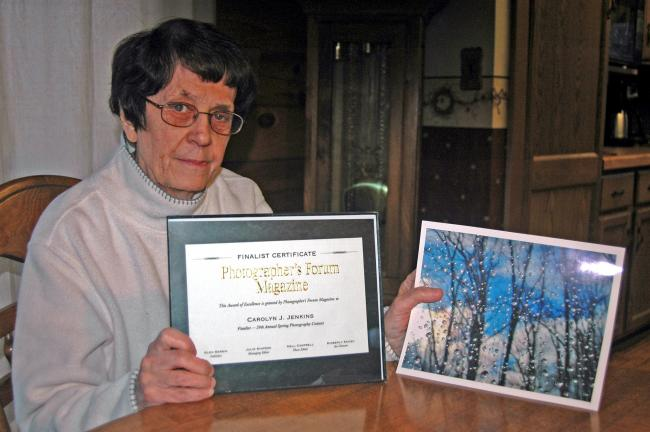 DONALD R. SERFASS/TIMES NEWS Carolyn Jenkins, Barnesville, displays the finalist certificate and winning photo that earned her national recognition by a California-based photography magazine.