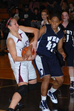 RON GOWER/TIMES NEWS Lehighton's Sheena White pulls the ball away from Pocono Mountain West's Shana Clark during Saturday's MVC showdown.
