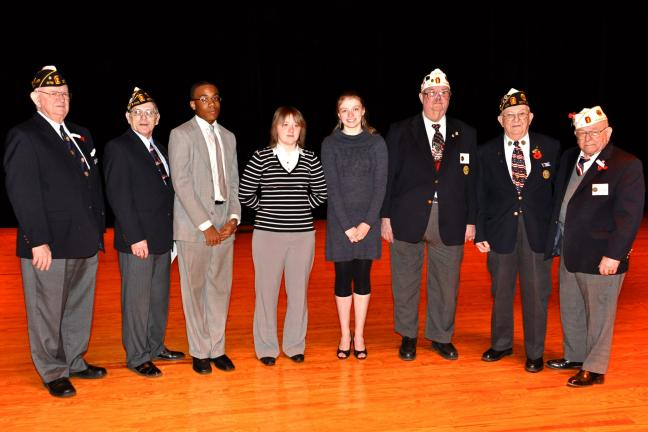 VICTOR IZZO/SPECIAL TO THE TIMES NEWS Contestants and Legion officials gather on stage after the completion of the Eastern Judicial Sectional Oratorical Contest sponsored by the Pa. American Legion which was held this past Saturday in the Jim Thorpe…