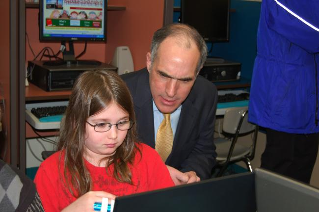 Gail Maholick/TIMES NEWS Audrey Schaeffer, a student at Mahoning Elementary School, shows U.S. Sen. Bob Casey her progress in learning about Marian Anderson on a computer,which was purchased with American Recovery and Reinvestment Act (ARRA) funds.