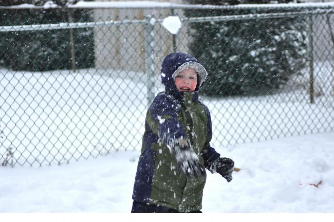 RON GOWER/TIMES NEWS Tyler Black, 4, tossing a snowball while playing outside in the snow. Tyler is the son of Joshua and Stephanie Black of Lake Hauto.