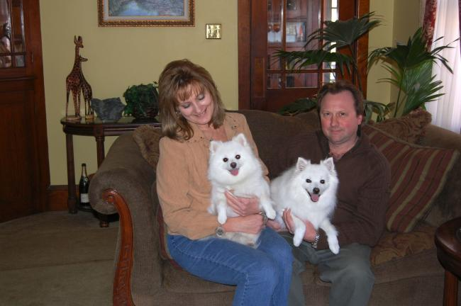 Sandra Wingert holds Pixie Dust, a toy American Eskimo dog, and Todd holds Jewels, the first dog of the breed that they owned.