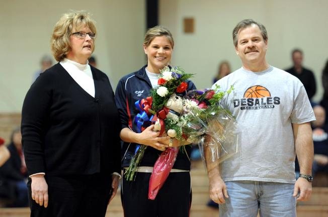 NANCY SCHOLZ/SPECIAL TO THE TIMES NEWS Northwestern graduate Caitlin Miller was honored recently during the DeSales women's basketball Senior Day ceremony. Miller leaves DeSales as the fifth-leading rebounder in school history. She is accompanied by…