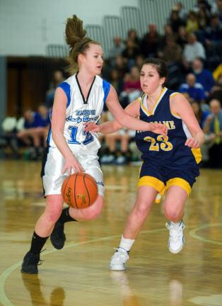 BOB FORD/TIMES NEWS Palmerton's Kristen Romano dribbles around Notre Dame's Allison Spirk as she makes a move to the basket.