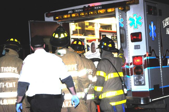 LARRY NEFF/SPECIAL TO THE TIMES NEWS Shooting victim, Jace J. Gill is loaded into an ambulance.