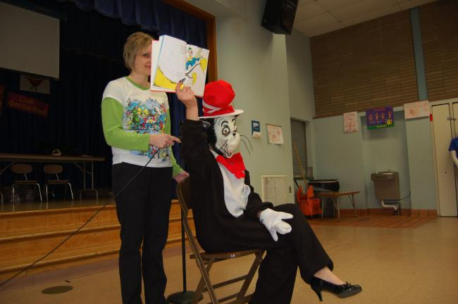 "Gail Maholick/TIMES NEWS Lisa Schatz assists the Cat in the Hat by holding the microphone while reading ""Sam I Am,"" to the students at Shull-David Elementary School."