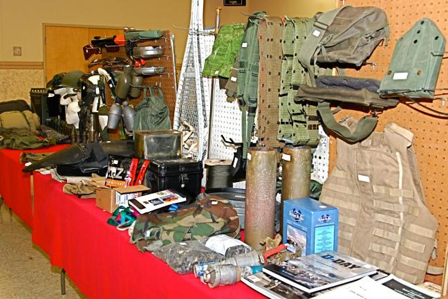 VICTOR IZZO/SPECIAL TO THE TIMES NEWS These table displays are typical of the vintage military items and materials that can be found at the Redball Military Transport Club's Winter Swap Meet being held this Saturday, March 6th, at Memorial Hall on…