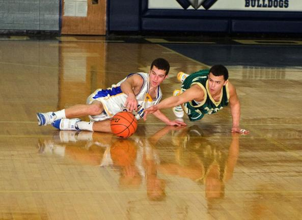 BOB FORD/TIMES NEWS Marian's Cody Decker (left) and Notre Dame of East Stroudsburg's Mike Aldaron battle for a loose ball in the District 11 Class A Boys semifinal on Tuesday night at Northern Lehigh.