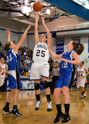 STEVE SHINKO/Special to THE TIMES NEWS Tamaqua's Amy Zehner takes a shot over Palmerton defenders Jen Snyder (left) and Kristen Romano (right) during Tuesday's District 11 Class AAA girls semifinal game at Blue Mountain High School in Orwigsburg.