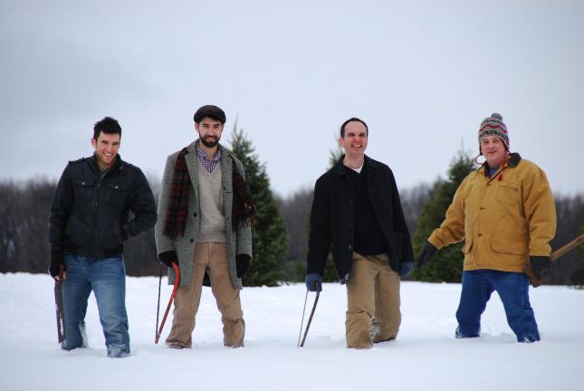 "STACEY SOLT/SPECIAL TO THE TIMES NEWS The main characters featured in the short film ""Branches,"" shot at Crystal Spring Tree Farm in Lehighton, pause during filming. The actors are, from left, Cuyle Carvin, Samuel Kirk, Tom Bartos and Jody Ebert."