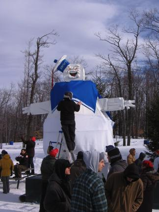 GARRETT CIMMS/SPECIAL TO THE TIMES NEWS Designers put the finishing touches on a giant Sta-Puff Marshmallow man sled, made entirely of cardboard. The sled ended up traveling backward through much of it's downhill run.