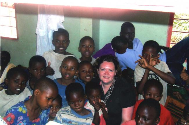Tamaqua native Rebecca McHale Ndikwiki is surrounded by children of the African orphanage where she worked.