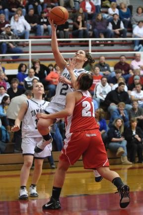 steve shinko/special to the times news Tamaqua's Elissa Streisel goes up for two as Mt. Carmel Area's Marisa Farronato defends. Looking on in the background is the Lady Raiders' Maria Streisel.