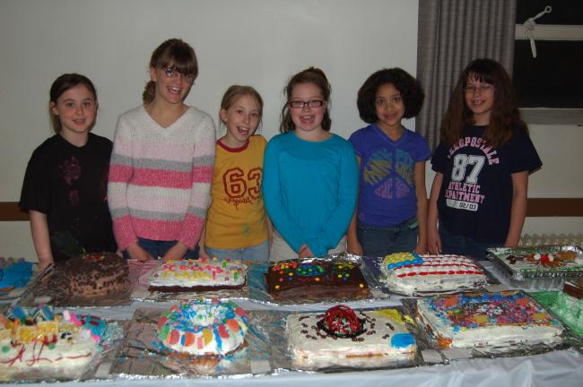 LINDA KOEHLER/TIMES NEWS Left to right: Girl Scouts Rachelle Kroboth, Ashleigh Miller, Katelyn Haupt, Krista Carlin, Maya Joan Hrusovsky and Julie M. McGowan, all of Troop # 33412, are ready to taste all the birthday cakes they helped make…