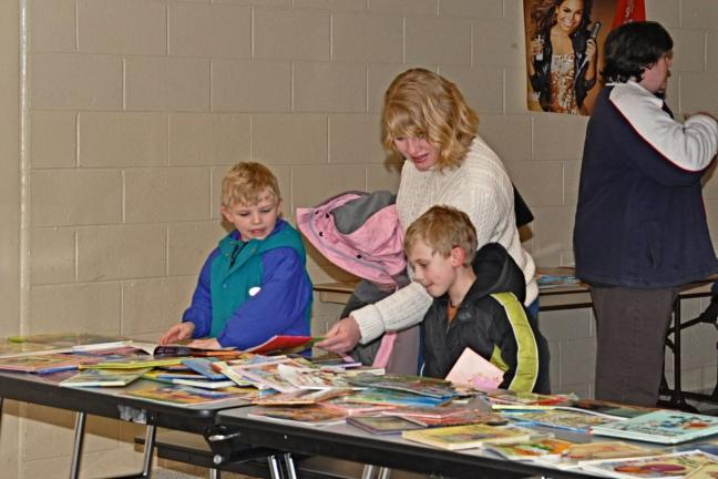"VICTOR IZZO/SPECIAL TO THE TIMES NEWS Looking over some of the hundreds of books available at the book swap held during ""Family Fun Night"" at the Penn Kidder Campus of the Jim Thorpe Area School District are Austin Fronheiser, age 4 (left) and his…"