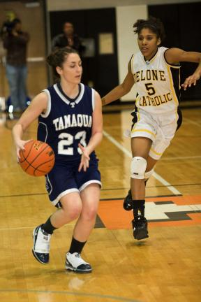 BOB FORD/TIMES NEWS Tamaqua's Elissa Streisel dribbles the ball down court as Delone Catholic's Sierra Moore moves up from behind in their PIAA Class 2A quarterfinal.