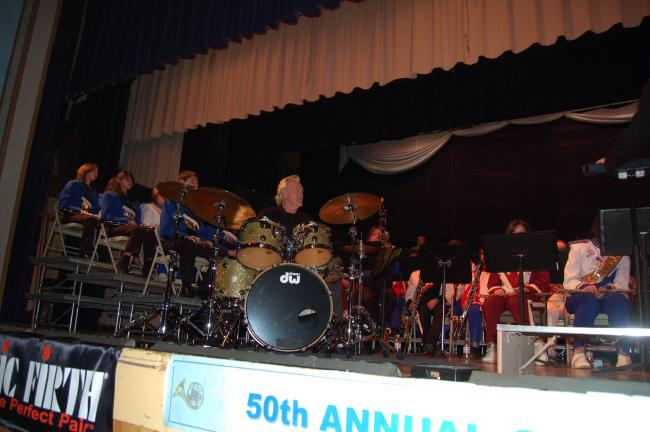 TERRY AHNER/TIMES NEWS Denny Seiwell, founding drummer of Paul McCartney and Wings, serves as a guest soloist during the Carbon County Band Festival's 50th anniversary Thursday night.