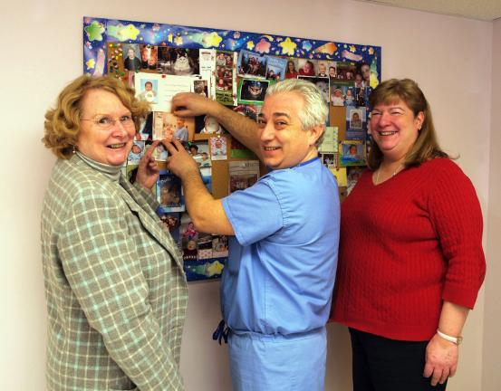 AL ZAGOFSKY/SPECIAL TO THE TIMES NEWS Certified Nurse Midwife Linda Anderson, left, Dr. Alessandro Boschi, and Certified Nurse Midwife JoAnn Haas add pictures of babies they delivered to the picture board at their Lehighton office. The trio wants…