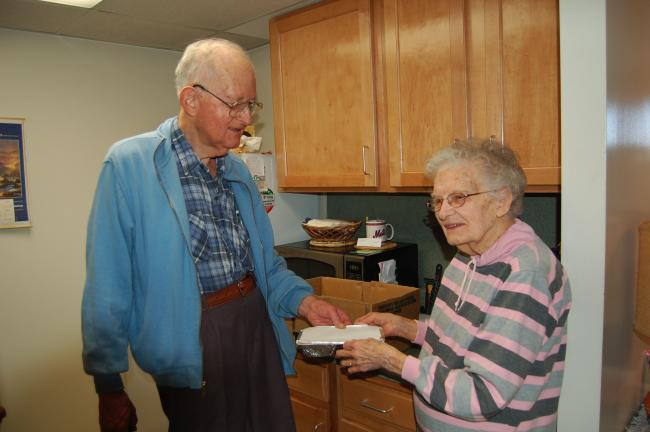 LINDA KOEHLER/TIMES NEWS George Ashman, a volunteer for Meals on Wheels, delivers the day's meals to satisfied client Mattie Eck at the Palmerton high rise.