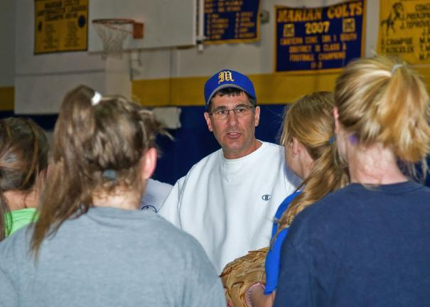 steve shinko/special to the times news Joe DeAngelo, Marian's new varsity head softball coach, discusses defensive strategy with his team during a recent indoor practice session.