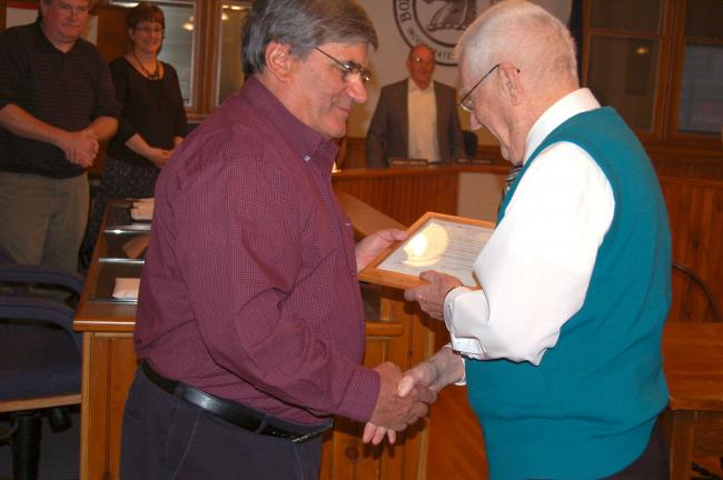 TERRY AHNER/TIMES NEWS Palmerton Borough Council Vice President Chris Olivia presents former mayor Peter J. Delich with a certificate of appreciation.