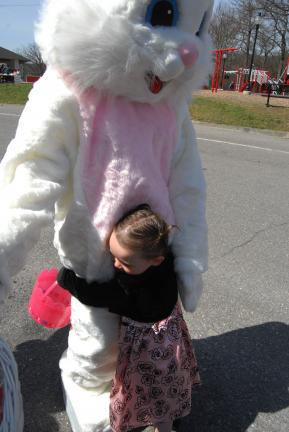 RON GOWER/TIMES NEWS Two-year-old Veronica Wildrick of Lansford gives the Easter bunny a meaningful hug when the rabbit arrived for an Easter egg hunt in Lansford on Saturday. The egg hunt was sponsored by the Lansford Alive Improvement Committee.