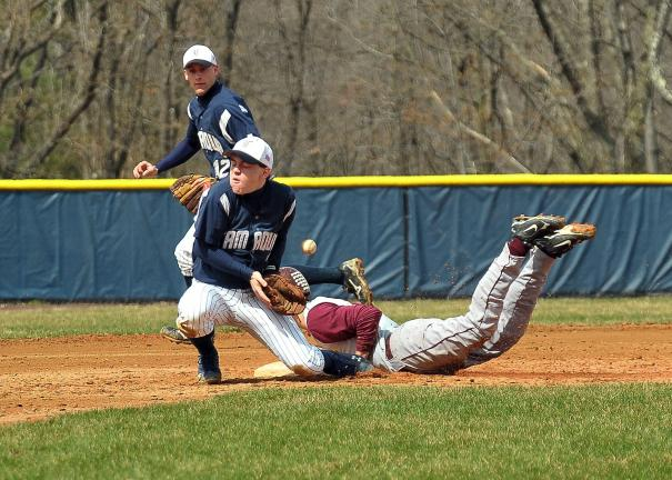 STEVE SHINKO/SPECIAL TO THE TIMES NEWS Tamaqua's Derek Linkhorst juggles the ball as Lehighton's Tyler Hill steals second base during Saturday's game at Tamaqua. The Raiders' Adam Smarr (12) backs up the play.