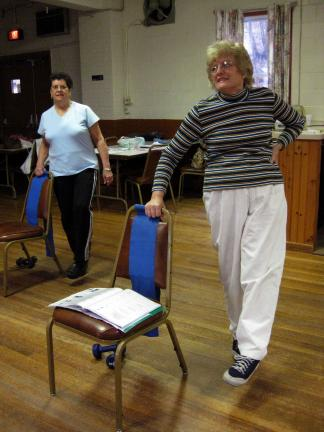 MARY ANN ENDY/Special to the TIMES NEWS Doris Oertner (right), adult stretch instructor, teaches her class at the Vigilant Fire Co. in Slatington as one of her regular exercise partners (left) takes part in the routine.