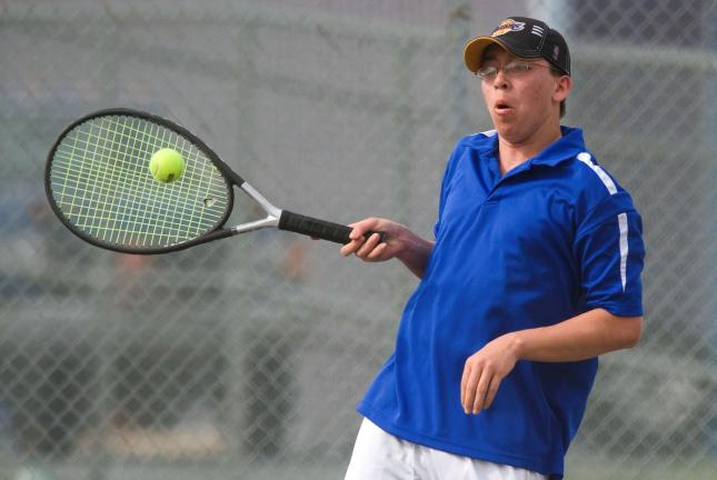 BOB FORD/TIMES NEWS Devon Frey of Palmerton returns a serve to Saucon Valley's Levi Wieand during their singles match at Palmerton on Tuesday.