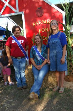 TIMES NEWS FILE PHOTO 2009 Carbon County Fair Queen Kristy Rodgers, seated, relaxes with Vanessa Lyn Hyska, left, first runner up; and Krisandra Livingston, right, second runner up.