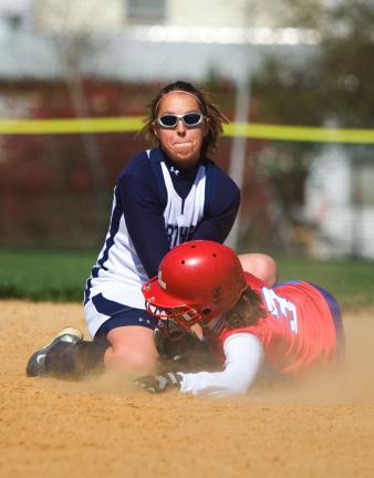 BOB FORD/TIMES NEWS Northern Lehigh shortstop Kristi Seiler puts the tag on Jim Thorpe's Amber Fiducia. Fiducia was throw out trying to steal second base.