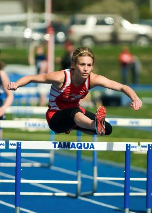 steve shinko/special to the times news Jim Thorpe's Samantha Herlan clears the final hurdle on her way to victory in the girls' 100 meter hurdle race against Tamaqua.