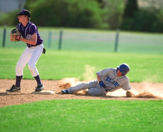 BOB FORD/TIMES NEWS Pleasant Valley's Travis Raseley slides in to second base as Es South's Matt Walters covers.