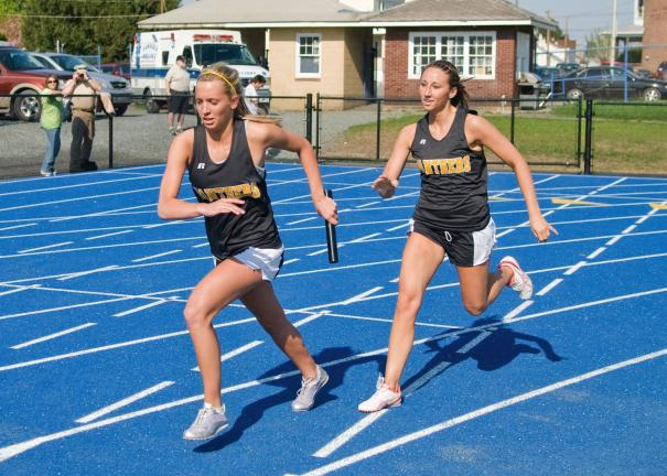 steve shinko/special to the times news Panther Valley's Krista Mantz (right) hands the baton off to Olivia Markovich during the girls' 400 relay Thursday against Tamaqua.