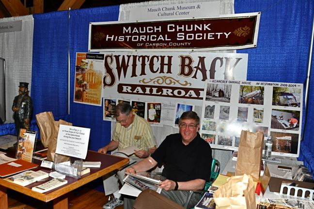 VICTOR IZZO/SPECIAL TO THE TIMES NEWS Keith Bellhorn (left) and Bob Stevenson staff the booth of the Muach Chunk Historical Society during the 2010 Carbon County Expo being held at Penn's Peak on the Maury Road in Jim Thorpe.