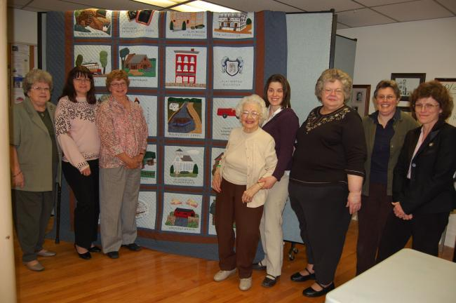 ELSA KERSCHNER/TIMES NEWS Working on the quilt top were Woman's Club of Slatington members Carol MacCrindle, Carol Kern, Donna Gasser, Phyllis Thomas, Jessica Rehrig, Dolly Cunfer, Louise Bechtel and Debbie Barhight.