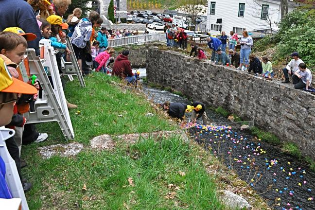 VICTOR IZZO/SPECIAL TO THE TIMES NEWS The SJRA Duck Derby in Jim Thorpe drew a large crowd of onlookers who gathered at different spots near the finish line across the street from Immaculate Conception Church on Broadway.
