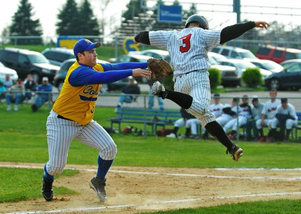 steve shinko/special to the times news Marian's Jim Stavinski tags out Tri-Valley's Tad Ney during a run down play between third base and home plate.