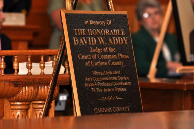AMY ZUBEK/TIMES NEWS A plaque, presented by the Carbon County Bar Association, will be hung in courtroom 2 in the Carbon County Courthouse in Jim Thorpe. The plaque will serve as a memorial to the late Judge David W. Addy, who passed away on Dec. 17…