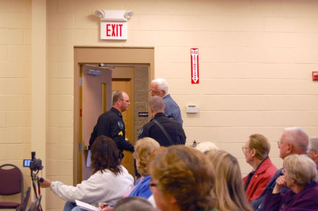 CHRIS PARKER/TIMES NEWS Rush Township resident Joe Shamonsky is escorted from the municipal meeting room Monday by Cpl. Duane Frederick and Patrolman Brian Thompson.