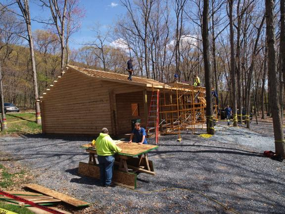 AL ZAGOFSKY/SPECIAL TO THE TIMES NEWS Crews from Mauch Chunk Lake Park and Eckley of the Pennsylvania Conservation Corps, and members of the Mauch Chunk Lake Park Maintenance Department, recently installed plywood roofing panels and black paper on…