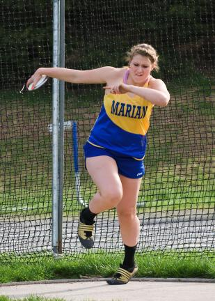 Steve Shinko/Special to THE TIMES NEWS Marian's Gillian Ferko winds up as she prepares to throw the disc during a recent track meet .