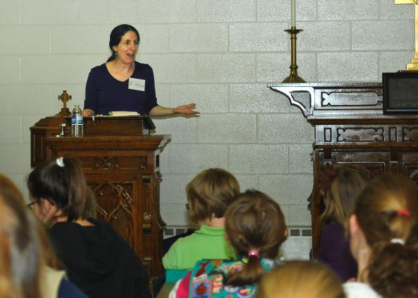 "STEVE SHINKO/SPECIAL TO THE TIMES NEWS Author Marie Lamba reads some excerpts from her young adult novel, ""What I Meant..."", during a recent visit with Tamaqua area Girl Scouts at St. John United Church of Christ in Tamaqua."