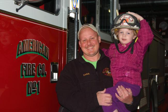 CHRIS PARKER/TIMES NEWS American Fire Co. No. 1 Second Assistant Fire Chief Joe Greco with a future firefighter - his 3-year-old daughter, Lucy.