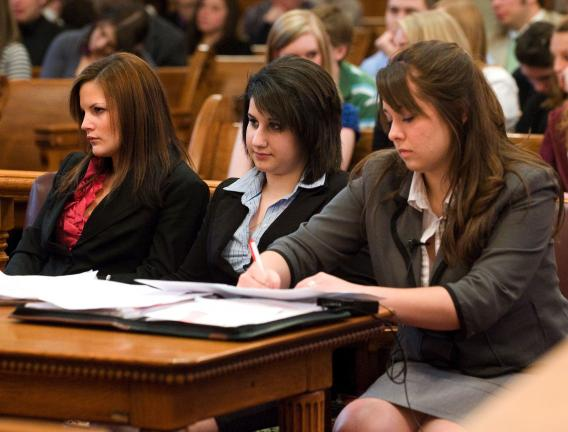 BOB FORD/TIMES NEWS Marian Catholic High School's mock trial team listen's to testimony during a mock trial held at the Carbon County Courthouse Friday morning. Marian's defense team consisted of, from left, Christina Leone, Victoria Vetter and…