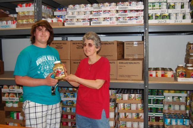 MacKenzie Fegely is doing his senior project about the food bank where he volunteers each Thursday. He is seen with Dale Breyfogle, director of the Northern Lehigh Food Bank.