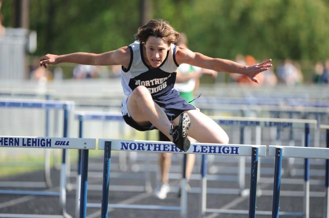 NANCY SCHOLZ/Special to THE TIMES NEWS Northern Lehigh's Dave Getz clears the 110 high hurdles en route to a first place finish in 17.1.