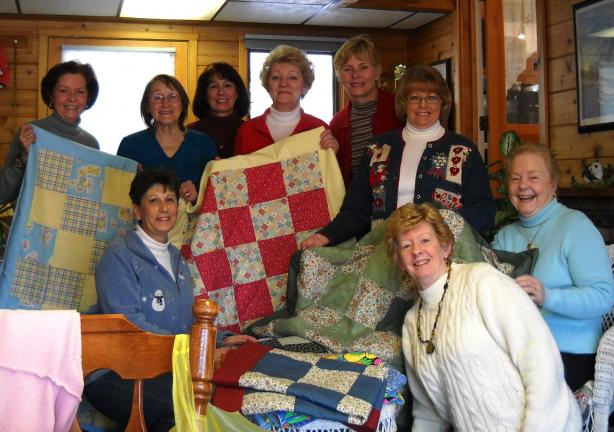 "SPECIAL TO THE TIMES NEWS Members of the GFWC Western Pocono Women's Club made 20 quilts for the Pocono Chapter of ""Quilts for Kids."" Some of them are: Back row, left to right, Carolyn Andrews, Margaret Kluk, Pat Walizer, Linda Bryfogle, Greta…"