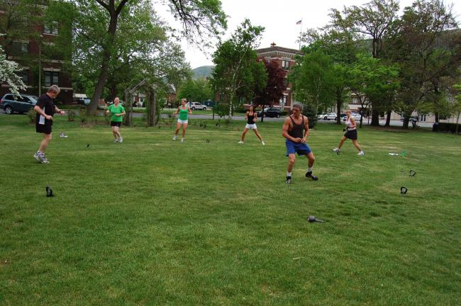 TERRY AHNER/TIMES NEWS  Instructor Jake Dempsey (center) leads this group of participants through the Kettlebell Conditioning Class outdoors in the Palmerton Borough Park.