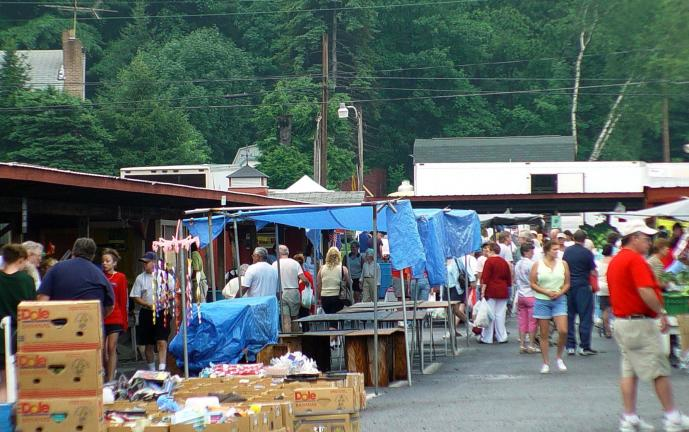 DONALD R. SERFASS/TIMES NEWS File Photo Customers browse through vendors' wares at the Hometown Farmer's Market. Rumors that the market on Route 54 in Hometown is closing are untrue, said its owners, Andrea and Robert Dunn.